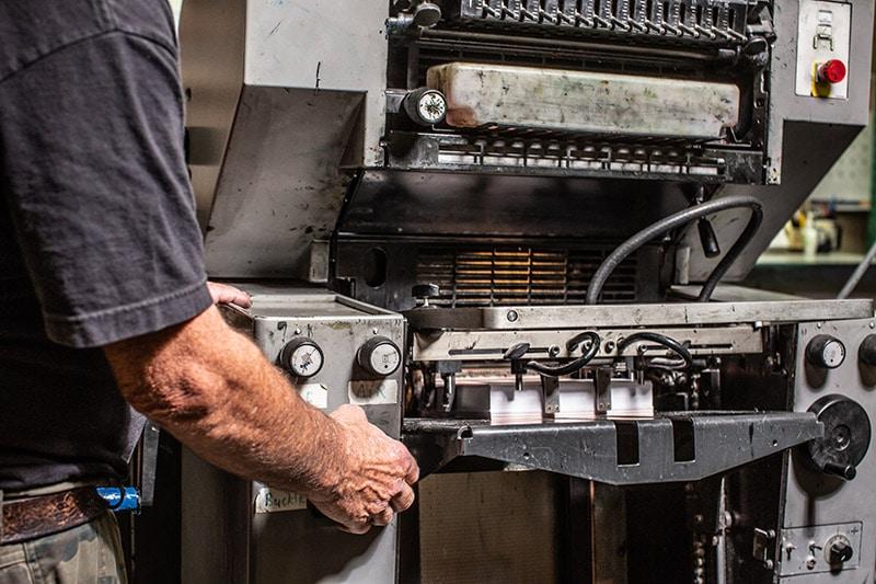 man at printer